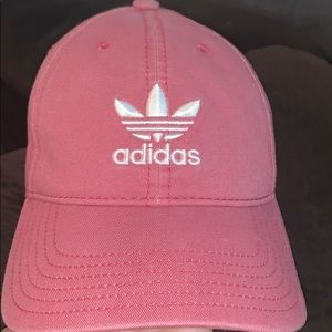 A pink adidas hat